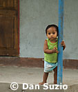Child on porch, Timor-Leste
